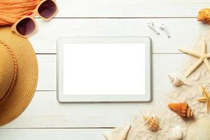 Summer background with blank screen phone and beach accessories on white wooden background top view with copy space. photo