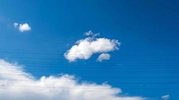 Electric power transmission lines and blue sky photo