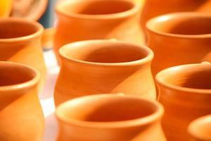 Kulhar - Brown Earthen cups in a row photo