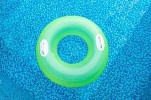 Swim ring in blue swimming pool photo