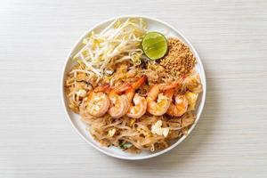 Stir-fried noodles with shrimp and sprouts or Pad Thai - Asian food style photo