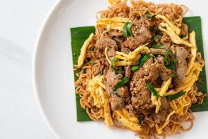 Stir-fried instant noodle with pork and egg - Asian local street food style photo