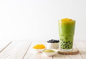 Matcha green tea latte with bubble and honey bubbles photo
