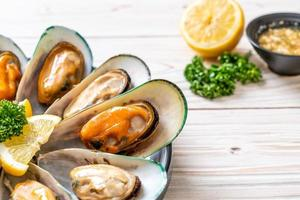 Seafood mussels with lemon and parsley photo
