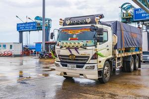 Colorful Thai truck leaves the ferry on Koh Samui, Thailand, 2018 photo