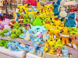 Colorful Pokemon Pikachu plush toys in Bangkok airport Thailand. photo