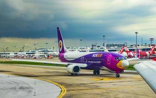 Nokair airline during storm at Bangkok Suvarnabhumi Airport, Thailand, 2018 photo