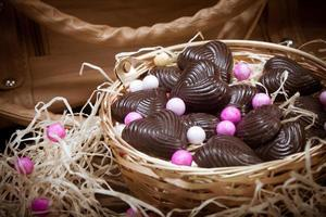 Home made chocolates in a basket photo