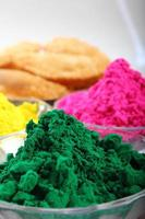 Colorful powders on the table photo