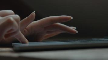 Fingers of woman scrolling and typing on laptop video