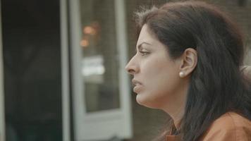 Woman sitting outside having conversation video