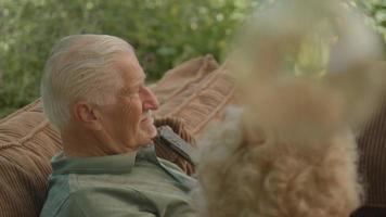 Man and woman sitting in garden having vivid conversation video