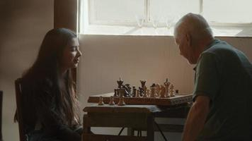Girl and man playing chess whilst man doubts about next move video