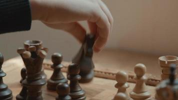Hand of girl moving and removing chess pieces on chessboard video
