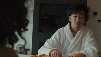 Man talks to woman at breakfast table video