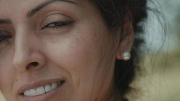 Right half of womans face smiling into camera lens video