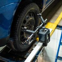 Sensor for adjusting a car camber photo