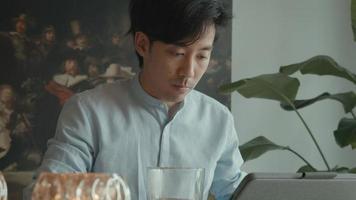 Man using laptop at table video