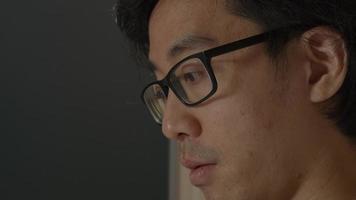 Screen laptop reflecting on mans eyes video