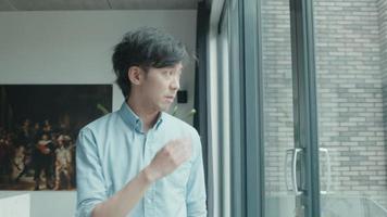Man looks through window being sad video