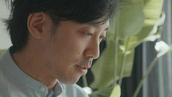 Man talks whilst watching screen laptop video