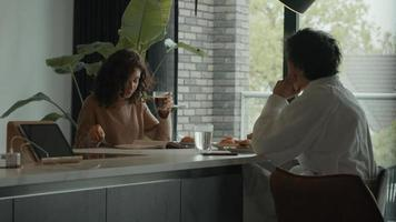 Woman and man having conversation at breakfast table video