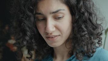 Worried woman looks around thinking video