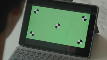 Man talks to green screen laptop video