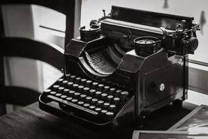 antique manual typewriter on the table photo
