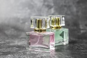 Perfume bottle on a black background photo