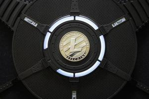 Litecoin Cryptocurrency coin on a PC computer graphic card photo