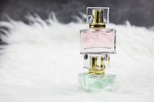 Perfume bottles on white fur photo