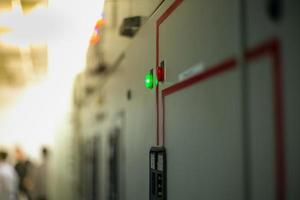 Closeup lighting indicator on the control carbinet in the electrical room photo
