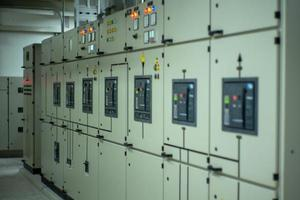 Blurred lighting indicator on the control cabinet in the electrical room. photo