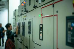 Blurred portrait of technician doing the preventive maintenance in the control room photo