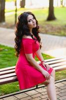 Portrait of a beautiful young girl with long dark wavy hair photo
