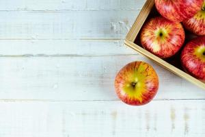Fresh red apples on wooden background. photo
