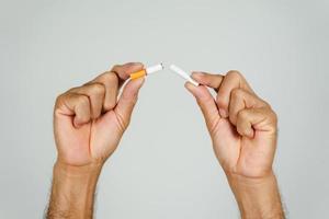 Man hand crushing cigarette, Concept Quitting smoking,World No Tobacco Day. photo