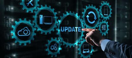 Businessman is pressing on the virtual screen Update Software Computer photo