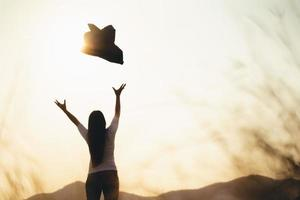 Happy successful business woman throwing her coat in the air. Business Freedom Success Concept. photo