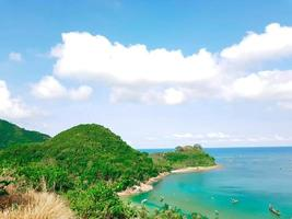 Green hills and blue water photo