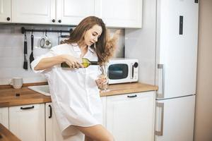 Young woman with glass of wine at home. photo