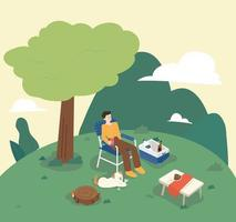 A man is camping while sitting on a chair in the open nature. There is a table and a cooler around him, and a dog is sitting next to him. flat design style minimal vector illustration.