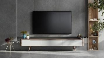 Mockup a TV wall mounted in a dark room with concrete wall. photo