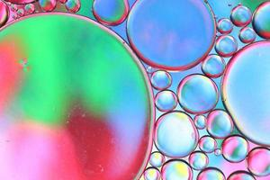 Colored drops of oil on the water. Background or texture. photo