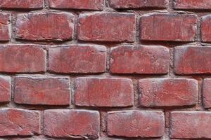 Red old brick wall. Interesting texture or background. photo