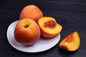 Peach cut on a plate. Exotic healthy fruit. photo