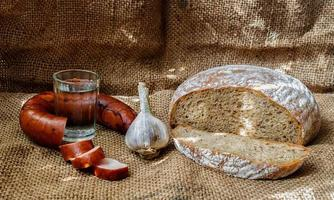 Simple rustic food. Bread and sausage photo