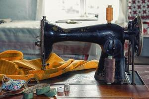 Old sewing machine. Retro equipment and still life. photo