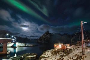 Aurora borealis over Hamnoy village with bridge at Lofoten islands photo